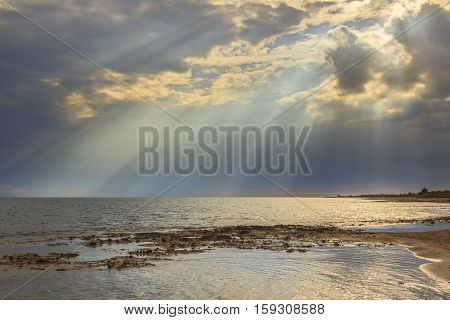 Salento coast: horizon sea with cloudy sunset. Apulia,ITALY. Typical beach with sandy coves and cliffs from Torre Pali to Pescoluse. Shoreline dominated by cloudscape.