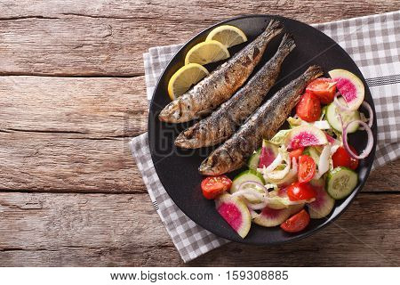Grilled Sardines With Fresh Vegetable Salad Close-up. Horizontal Top View