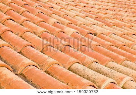 New roof with orange ceramic tiles closeup