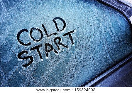 Cold start message written on frozen car windshield window