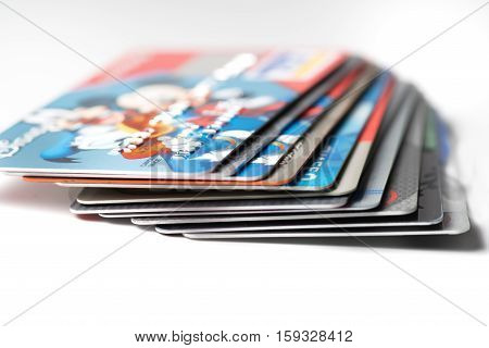 Close up of stack of credit cards on white background,illustrative editorial