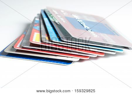 Close up of a stack of credit cards on white background,illustrative editorial