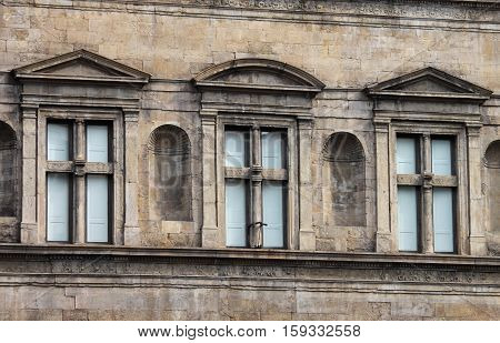 Some closed windows in a renaissance palace