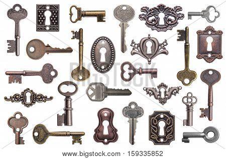 Set of old keys and keyholes isolated on white background