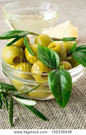 Olives With Leaves And Rosemary In A Small Glass