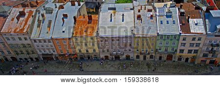 Old street with colourful buildings in Lviv