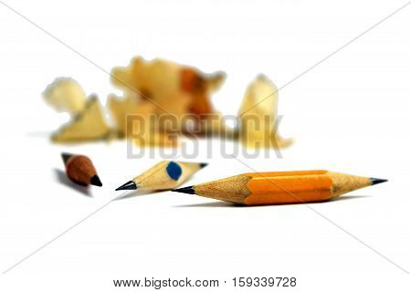 The end of the old technologies. Selected focus. The end of a pencil. Concept. / Pension. Death. Life style. End of career. / Isolation on a white background. The final. Finish.