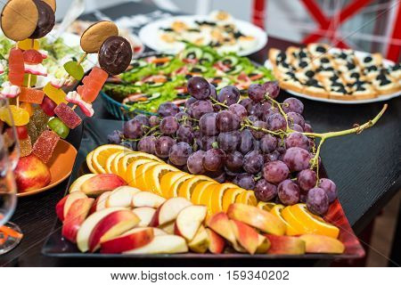 delicious red grape and fruit slices on the table