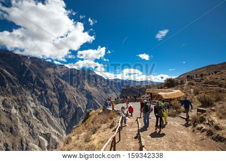 AREQUIPA, PERU - JULY 15 tourists watching condors in the Colca Canyon at Arequipa Peru on july 15th, 2015.
