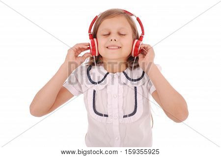 Happy young girl listening to music isolated on white