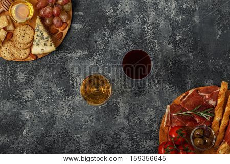 Cheese and meat appetizer selection.Top view with copy space.