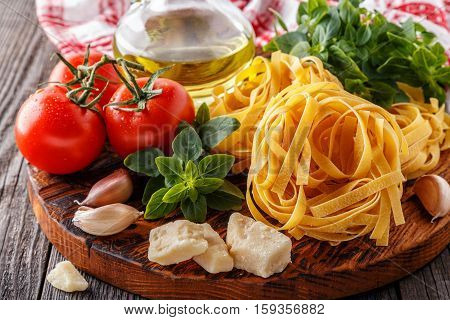 Cutting board with ingredients - concept of Italian cuisine.