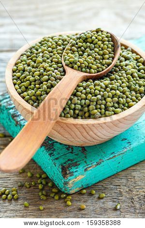 Wooden Spoon In A Bowl Of Mung Beans.