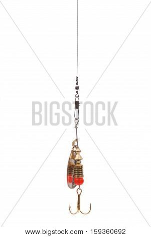 Golden fishing spoon hanging top of the screen isolated on white