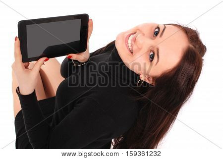 Happy student teenage girl with tablet pc. Sitting sideways isolated on white