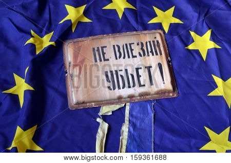 EU and Ukraine Flag with Vintage looking yellow Danger do not enter warning sign (RU