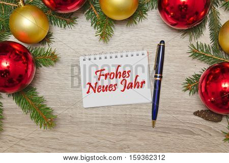 Notebook with German text Frohes neues Jahr (HAPPY NEW YEAR) christmas decoration