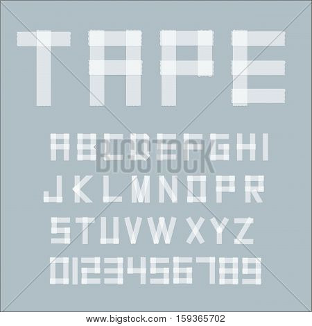 White transperent adhesive tape letters isolated on grey background.