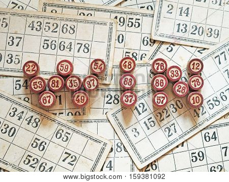 Tabletop old lotto game with wooden elements. Cards bingo. Keywords win