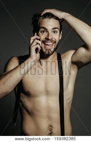 Handsome Man Talks On Smartphone