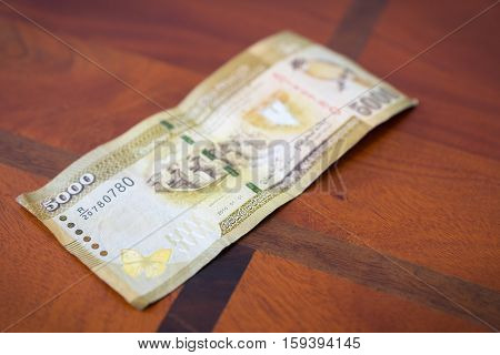 Five Thousand Rupees.