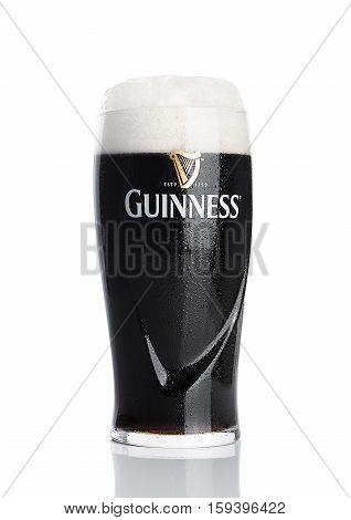 LONDON UK - NOVEMBER 29 2016: Glass of Guinness original beer on white background. Guinness beer has been produced since 1759 in Dublin Ireland.