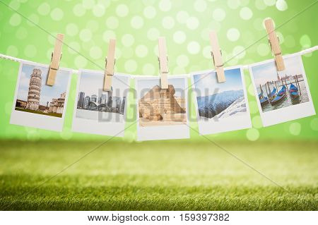 Close-up Of Photos Of Vacation Hanging On Rope With Wooden Clip