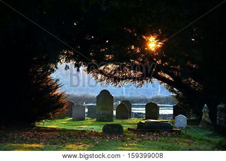 Morning light on graves in a churchyard