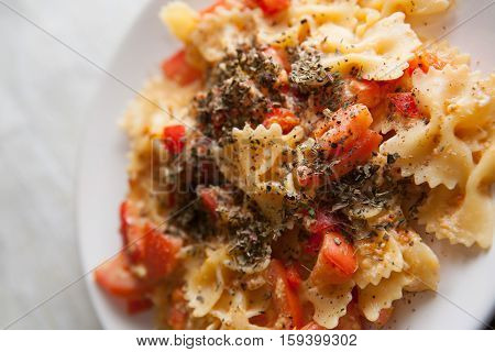 farfalle with tomato and paprika closeup photo