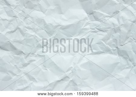 White creased paper background texture. Crumpled white paper background