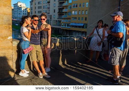 Tourists On The Ponte Vecchio In Florence, Italy