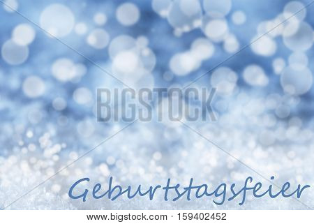 German Text Geburtstagsfeier Means Birthday Party. Blue Bokeh Christmas Background Or Texture With Snow. Copy Space For Your Text Here