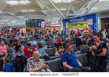People At The Departure Lounge Of London Stansted Airport