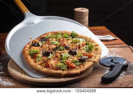 Caesar Pizza On Messy Wooden Background.
