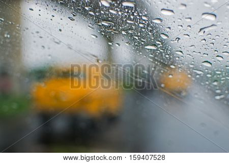 Rainy street of Kolkata West Bengal India. Blurred view of famous yellow taxis of Kolkata moving on street with flyover in background monsoon Indian stock image.