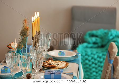 Table served for Hanukkah in living room, closeup