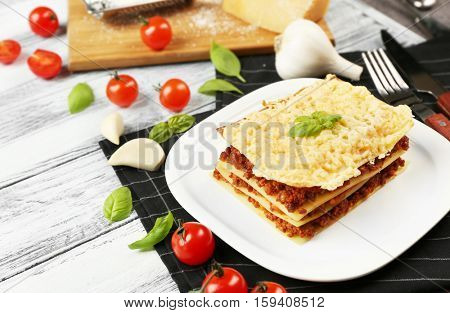 Homemade meat lasagna on white wooden table