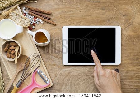 woman searching the cooking menu and preparing food ingredient before cooking