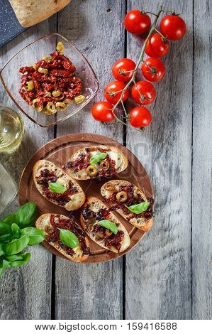 Appetizer Bruschetta With Sun-dried Tomatoes, Olives And Mozarel