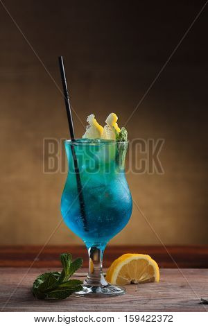 Blue Lagoon Cocktail On Gritty Vintage Background.