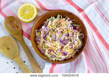 Salad coleslaw in a wooden bowl rustic style Top view.