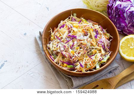 Salad coleslaw in a wooden bowl Top view with copy space.