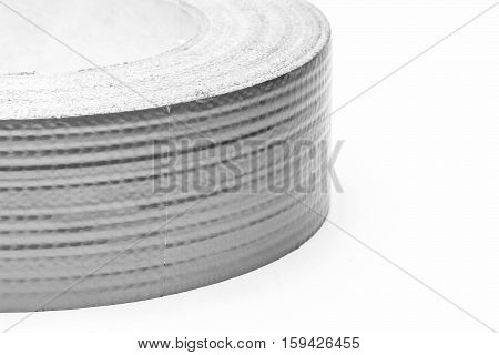 Construction and assembly adhesive tape close-up on a white background.