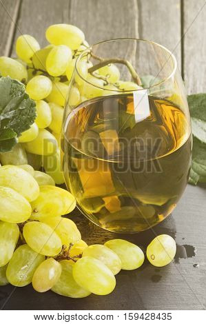 White Wine And Grapes On A Dark Background. Toning