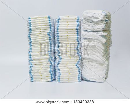 Three Stacks of diapers on white background