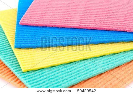 Colorful sponges on white background, close up picture.
