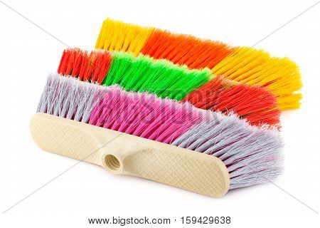 Three colorful brooms isolated on white background.