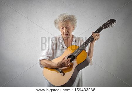 Old lady with a guitar