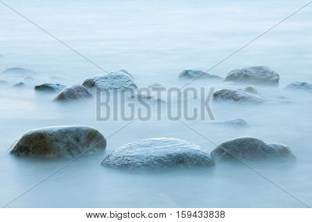 Long exposure of sea and stones in the water