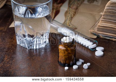 Bunch Of White Pills With Glass Ampoules, Water